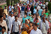 Visitors are walking towards the Taj Mahal building, in Agra.