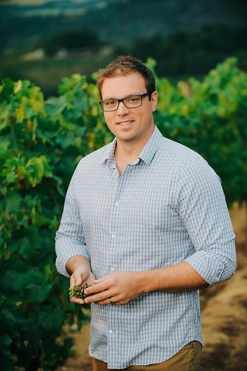 Vineyard Manager at Erath Winery standing in Vineyard