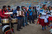 The music bands plays for the dancers days and nights during the celebration of the Lord of Qoyllur Rit'i (The Lord of the Shining Snow), in Cusco, Peru.