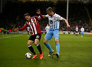 Billy Sharp of Sheffield Utd in action with Nathan Clarke of Coventry City  during the English League One match at Bramall Lane Stadium, Sheffield. Picture date: April 5th 2017. Pic credit should read: Simon Bellis/Sportimage