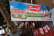 A company advertises dairy products of butter and cheese, in the village of Bairat on the West Bank of Luxor, Nile Valley, Egypt. Egypt accounts for 16.3 per cent of the  Africa & Middle East dairy market value. Although Egypt is considered one of the largest milk producers in Africa and the Middle East region, there is a negative balance  between supply and demand. Moreover, according  to <br /> BMI 2010 forecasts, consumption is expected to remain higher than local production over the 2008-2017 period.