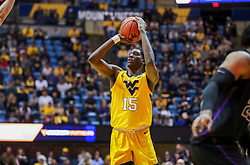 Mar 20, 2019; Morgantown, WV, USA; West Virginia Mountaineers forward Lamont West (15) shoots during the second half against the Grand Canyon Antelopes at WVU Coliseum. Mandatory Credit: Ben Queen