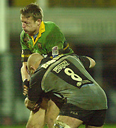 Photo Peter Spurrier<br /> 07/12/2002<br /> European Rugby - Heineken Cup Northamton vs Cardiff.<br /> Saints full Back Nick Beal is tackled by cardiff's No.8, Dan Baugh