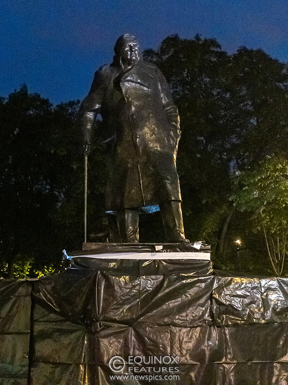London, United Kingdom - 17 June 2020<br /> Police guard Winston Churchill statue. Its graffiti was being cleaned with solvents after the statue was uncovered from its protective scaffolding and sheet metal following Black Lives Matter protests, Parliament Square, London, England, UK.<br /> (photo by: EQUINOXFEATURES.COM)<br /> Picture Data:<br /> Photographer: Equinox Features<br /> Copyright: ©2020 Equinox Licensing Ltd. +443700 780000<br /> Contact: Equinox Features<br /> Date Taken: 20200617<br /> Time Taken: 22251252<br /> www.newspics.com