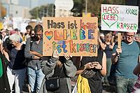 """13 OCT 2018, BERLIN/GERMANY:<br /> Demonstratin mit Plakat Hass ist krass- Liebe ist krasser"""", Demonstration """"#unteilbar"""" - """"Solidaritaet statt Ausgrenzung - fuer eine offene und freie Gesellschaft"""", Gertraudenstrasse / Strasse des 17. Juni<br /> IMAGE: 20181013-01-004<br /> KEYWORDS: Demo"""