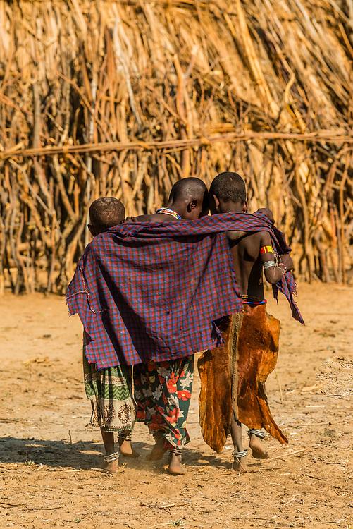 Arbore tribe girls walking arm in arm, Omo Valley, Ethiopia.