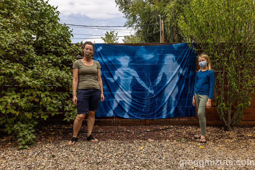 Allicia Keefe, Evelyn Keefe. Jessie Swimeley's Pandemic in Blue Take Two! 5' x 7' cyanotype mural. September 18, 2021 at Surel's Place in Garden City, Idaho.