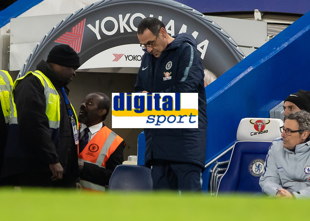 Football - 2018 / 2019 Emirates FA Cup - Fifth Round: Chelsea vs. Manchester United <br /> <br /> Maurizio Sarri, Manager of Chelsea FC, checks his watch to see how long he has left at Stamford Bridge<br /> <br /> COLORSPORT/DANIEL BEARHAM