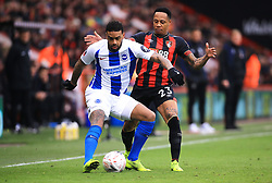 Brighton & Hove Albion's Jurgen Locadia (left) and Bournemouth's Nathaniel Clyne battle for the ball during the Emirates FA Cup, third round match at the Vitality Stadium, Bournemouth.