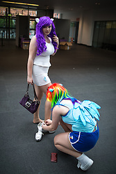 © Licensed to London News Pictures . 26/07/2015 . Manchester , UK . A woman helps another with her costume inside the venue . Comic Con convention at Manchester Central Convention Centre . Photo credit : Joel Goodman/LNP