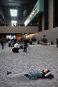 Ai Weiwei, one of China's leading conceptual artists, has undertaken the eleventh commission in The Unilever Series at Tate Modern in London. Sunflower Seeds is made up of millions of small works, each apparently identical, but actually unique. These life-sized sunflower seed husks are intricately hand-crafted in porcelain. Each seed has been individually sculpted and painted by specialists working in small workshops in the Chinese city of Jingdezhen. Far from being industrially produced, they are the effort of hundreds of skilled hands. Poured into the interior of the Turbine Hall's vast industrial space, the 100 million seeds form a seemingly infinite landscape. Sunflower Seeds is a sensory and immersive installation, on which visitors can touch, walk on and listen to as the seeds shift under our feet. Porcelain is almost synonymous with China and, to make this work, Ai Weiwei has manipulated traditional methods of crafting what has historically been one of China's most prized exports. Sunflower Seeds invites us to look more closely at the 'Made in China' phenomenon and the geo-politics of cultural and economic exchange today.
