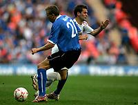 Photo: Tom Dulat.<br /> England v Estonia. UEFA European Championships Qualifying. 13/10/2007.<br /> Taavi Rahn of Estonia managed to stop Michael Owen of England racing with the ball