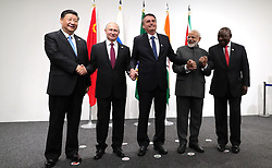 June 28, 2019 - Osaka, Japan - June 28, 2019. - Japan, Osaka. - China's President Xi Jinping, Russia's President Vladimir Putin, Brazil's President Jair Bolsonaro, India's Prime Minister Narendra Modi and South Africa's President Cyril Ramaphosa (from L to R) pose for a BRICS meeting on the sidelines of the 2019 G20 Summit at the INTEX Osaka International Exhibition Centre. (Credit Image: © Russian Look via ZUMA Wire)