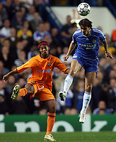 Photo: Paul Thomas.<br /> Chelsea v Barcelona. UEFA Champions League, Group A. 18/10/2006.<br /> <br /> Ronaldino (L) of Barcelona is out jumped by Khalid Boulahrouz.