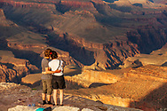 A couple on Shoshone point during a quiet sunset at Grand Canyon.
