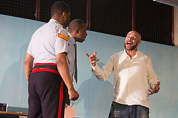 © Licensed to London News Pictures. 2 April 2014. London, England. Theatre Royal Stratford East presents Roy Williams' play KINGSTON 14 with Brian Bovell as Marucs, Derek Elroy as James and Goldie as Joker. Photo credit: Bettina Strenske/LNP