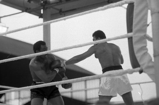Ali vs Lewis Fight, Croke Park,Dublin..1972..19.07.1972..07.19.1972..19th July 1972..As part of his built up for a World Championship attempt against the current champion, 'Smokin' Joe Frazier,Muhammad Ali fought Al 'Blue' Lewis at Croke Park,Dublin,Ireland. Muhammad Ali won the fight with a TKO when the fight was stopped in the eleventh round...Image of a hurt Lewis as he tries to back away from the attacking Ali.
