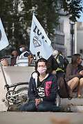 "Protester meditates at the ""Climate Justice is Migrant Justice"", outside Home Office, Marsham Street in central London on Friday, Sept 4, 2020. (VXP Photo/ Gio Strondl)"