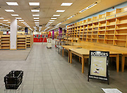 """Interior of borders bookstore after closure showing empty book shelves, Borders sign, display tables and shopping baskets. Borders bookstore in Oxford is one of 45 stores in the UK to close all its branches in the UK on 22 December. The chain went into administration earlier this month and had kept open all its stores while it attempted to find a buyer. Administrators MCR said all 45 Borders and Books Etc stores would close on 22 December. Borders has suffered from increased competition from online retailers and supermarkets. Borders employed 1,150 people in total. MCR has previously said Borders had """"severe cash flow pressures"""" and that several suppliers had stopped or reduced its credit, which made suppliers less willing to trade with the retailer and made it difficult for it to replenish its stock levels."""