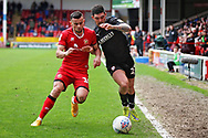 Barnsley midfielder Alex Mowatt and Walsall FC midfielder Zeli Ismail (10) during the EFL Sky Bet League 1 match between Walsall and Barnsley at the Banks's Stadium, Walsall, England on 23 March 2019.