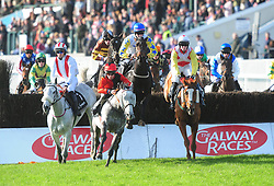 Well Tom and Daniel Holden (blue star & cap) jump the first to win the Ballymore Handicap Steeplechase during day two of the October Festival at Galway Racecourse.