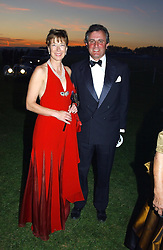 VISCOUNT & VISCOUNTESS ASTOR at the 2004 Goodwood Revival ball this year theme was a Venetian Masked Ball, held at Goodwood Motor Racing circuit, West Sussex on 4t September 2004.