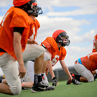 081215       Cable Hoover<br /> <br /> Sophomore Joseph Gaze and the rest of the Bengals varsity squad do up down drills during practice at Gallup High School Wednesday.