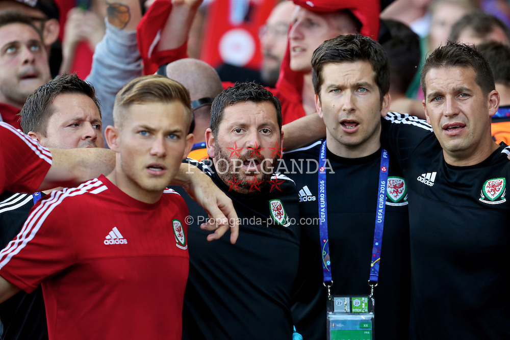 TOULOUSE, FRANCE - Monday, June 20, 2016: Wales' George Williams, equipment manager David Griffiths, Doctor Rhodri Martin and sports science coach Adam Owen before the final Group B UEFA Euro 2016 Championship match against Russia at Stadium de Toulouse. (Pic by David Rawcliffe/Propaganda)