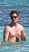 Dave Annable..Dave Annable drinking a beer while swimming..Celebrities on the Beach while attending the Labor Day weekend in Puerto Rico for Hollywood Domino Celebrity Golf Tournament..Palomino Island, Puerto Rico, USA..Saturday, September 03, 2011..Photo By CelebrityVibe.com..To license this image please call (323) 325-4035; or .Email: CelebrityVibe@gmail.com ; .website: www.CelebrityVibe.com.**EXCLUSIVE**