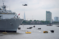 © Licensed to London News Pictures. 29/05/2014. London, England. The Royal Marines put on a  Capability Display at Greenwich from HMS Bulwark. HMS Bulwark is in London for a visit which will help mark the 350th anniversary of the Royal Marines. Photo credit : Mike King/LNP