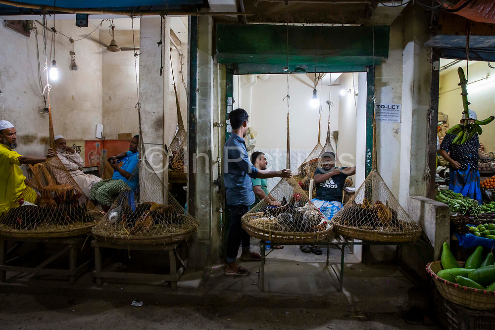 Live chickens for sale from cages in the Tejgaon railway district on the 23rd of September 2018 in Dhaka, Bangladesh.