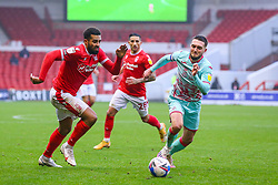 Cyrus Christie of Nottingham Forest is chased by Matt Grimes of Swansea City - Mandatory by-line: Nick Browning/JMP - 29/11/2020 - FOOTBALL - The City Ground - Nottingham, England - Nottingham Forest v Swansea City - Sky Bet Championship