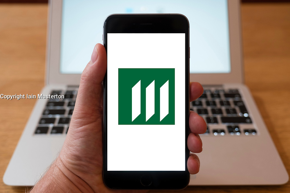 Using iPhone smartphone to display logo of Manulife the Canadian insurance company and financial services provider,