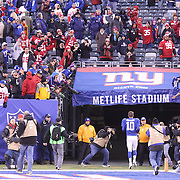 New York Giants quarterback Eli Manning leaves the field at the end of the game during the New York Giants V San Francisco 49ers, NFL American Football match at MetLife Stadium, East Rutherford, NJ, USA. 16th November 2014. Photo Tim Clayton