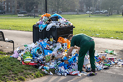 © Licensed to London News Pictures. 31/03/2021. London, UK. Council workers clear up huge amounts of rubbish left scattered around Primrose Hill in North West London  this morning after sunbathers and picnickers enjoy the hottest day of the year yesterday as weather forecasters predict further highs of 23c in the South East today. Photo credit: Alex Lentati/LNP