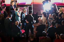 © Licensed to London News Pictures . 06/05/2015 . Leeds , UK . The leader of the Labour Party , ED MILIBAND , arrives and is embraced by Hillary Benn , to address an election rally at Leeds City Museum , on the eve of polls opening for the 2015 British general election . Photo credit : Joel Goodman/LNP