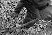 A pilgrim makes his way up the mountain in his barefeet.