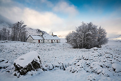 Snow covered winter landscape of Glen Coe at Blackrock cottage  in Scottish Highlands, Scotland, UK