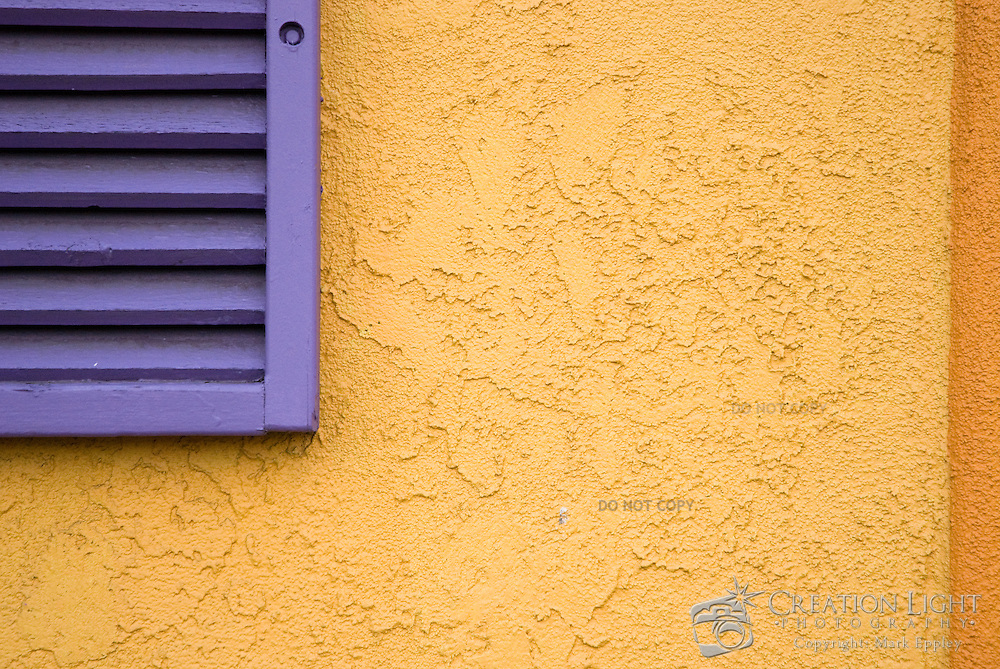 Mexico is known for painting with bright colors.  A Mexican Restuarant in Medford, Oregon is painted with a bright color scheme shown here with the window shutter and stucco wall.