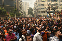 March 28, 2019 - Dhaka, Bangladesh - People gather at a burning high-rise building in Dhaka, capital of Bangladesh, on March 28, 2019. At least one person has died and 30 others rushed to hospital as a massive fire engulfed a high-rise building in Bangladesh capital Dhaka's upmarket Banani Thursday afternoon, a hospital official said. (Credit Image: © Salim Reza/Xinhua via ZUMA Wire)