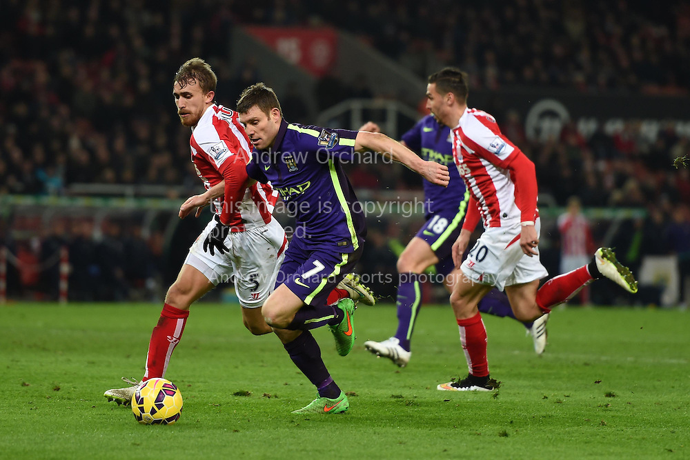James Milner of Manchester city makes a break. Barclays Premier League match, Stoke city v Manchester city at the Britannia Stadium in Stoke on Trent , Staffs on Wed 11th Feb 2015.<br /> pic by Andrew Orchard, Andrew Orchard sports photography.