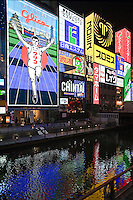 Glico Sign at Dotombori a district, famous for its neon and mechanized signs, including candy manufacturer Glico's giant electronic display of a runner crossing the finish line, moving giant crabs and other dramatic kitsch.