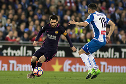 BARCELONA, April 30, 2017  Barcelona's Lionel Messi(L) vies with Espanyol's Javi Fuego during the Spanish first division (La Liga) soccer match between RCD Espanyol and FC Barcelona at RCDE Stadium in Barcelona, Spain, April 29, 2017. Barcelona won 3-0. (Credit Image: © Pau Barrena/Xinhua via ZUMA Wire)
