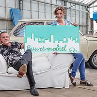 Nederland, Utrecht, 24 mei 2017.<br /> Jeroen Blokland en Moyra Haaxma, oprichters van Buurt Mobiel.<br /> Wij brengen vervoer en kennis van de voorzieningen in de wijk samen in de dienst Buurt Mobiel. <br /> <br /> Buurt Mobiel biedt elektrisch vervoer in Utrecht. Dit is duurzaam, plezierig, comfortabel en veilig over korte afstanden. Vrijwilligers besturen de voertuigen en halen mensen thuis op, brengen hen weg of stoppen onderweg om iemand in te laten stappen. Er zijn geen haltes of vaste opstappunten. Even Buurt Mobiel bellen en u heeft flexibel vervoer dat altijd in de buurt is. Onze chauffeurs zijn de ambassadeurs van de wijk. Het doel is dat bewoners en bezoekers van de wijk beter gebruik kunnen maken van al het moois dat er al is en dat vervoer minder een belemmering hoeft te zijn om erop uit te trekken.<br /> <br /> <br /> Foto: Jean-Pierre Jans