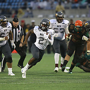 Quarterback Larry Brihm (2) runs the football during the Florida Classic NCAA football game between the FAMU Rattlers and the Bethune Cookman Wildcats at the Florida Citrus bowl on Saturday, November 22, 2014 in Orlando, Florida. (AP Photo/Alex Menendez)
