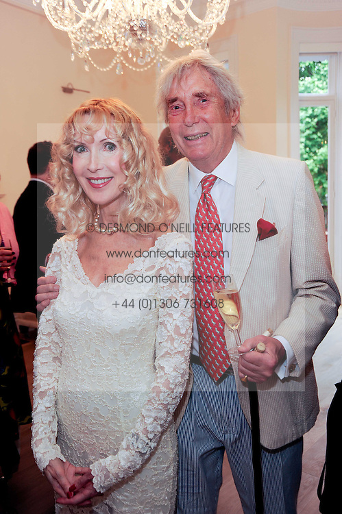 Sculptor DAVID WYNNE and BASIA BRIGGS at a reception to celebrate the repairs on the Queen Elizabeth Gate in Hyde Park after it's successful repair following damaged sustained in a traffic accident in early 2010.  The party was held at 35 Sloane Gardens, London on 7th June 2010.