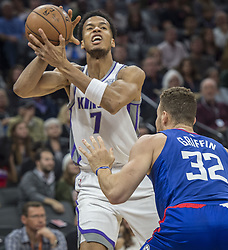November 25, 2017 - Sacramento, CA, USA - The Sacramento Kings' Skal Labissiere (7) is fouled by the Los Angeles Clippers' Blake Griffin (32) in the first half on Saturday, Nov. 25, 2017, at Golden 1 Center in Sacramento, Calif. (Credit Image: © Hector Amezcua/TNS via ZUMA Wire)