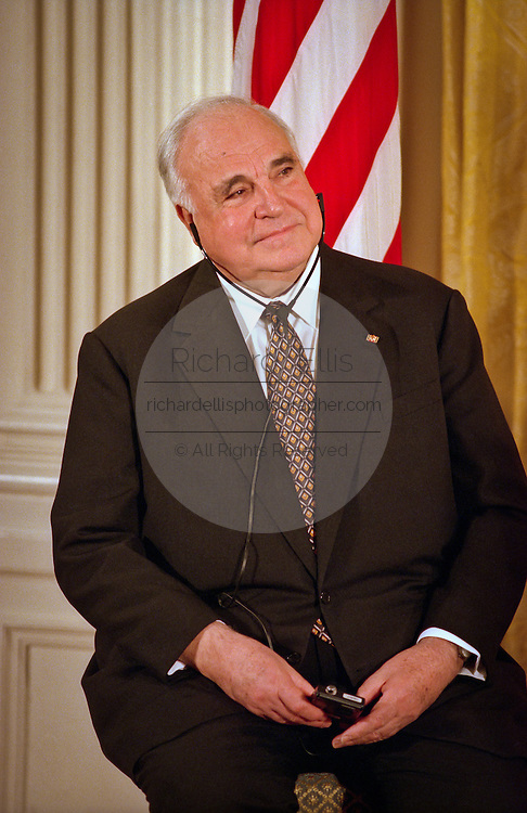 Former German Chancellor Helmut Kohl listens to President Bill Clinton during the Medal of Freedom ceremony honoring Kohl at the White House April 20, 1999. Kohl received the medal for his many years of good relations with the U.S and is the first foreigner to receive the honor since 1991.