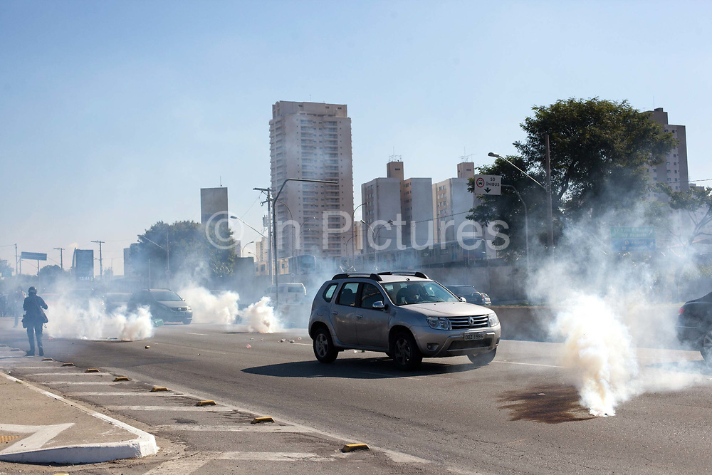 Members of the public were affected by the protests, when protesters tried to block the main highway going to Itauquera stadium, Police kept the traffic moving but fired tear gas, this endangered motorists, inlcuding a female scooter rider having btreathing problems due to the gas. Police clash with several hundred protesters in Sao Paulo, Brazil, using tear gas and stun grenades on the opening day of the FIFA World Cup 2014. There were some arrests and injuries inlcuding a CNN producer. The protesters were dispearsed relatively quickly due to the Brazilian Police's early show of force.