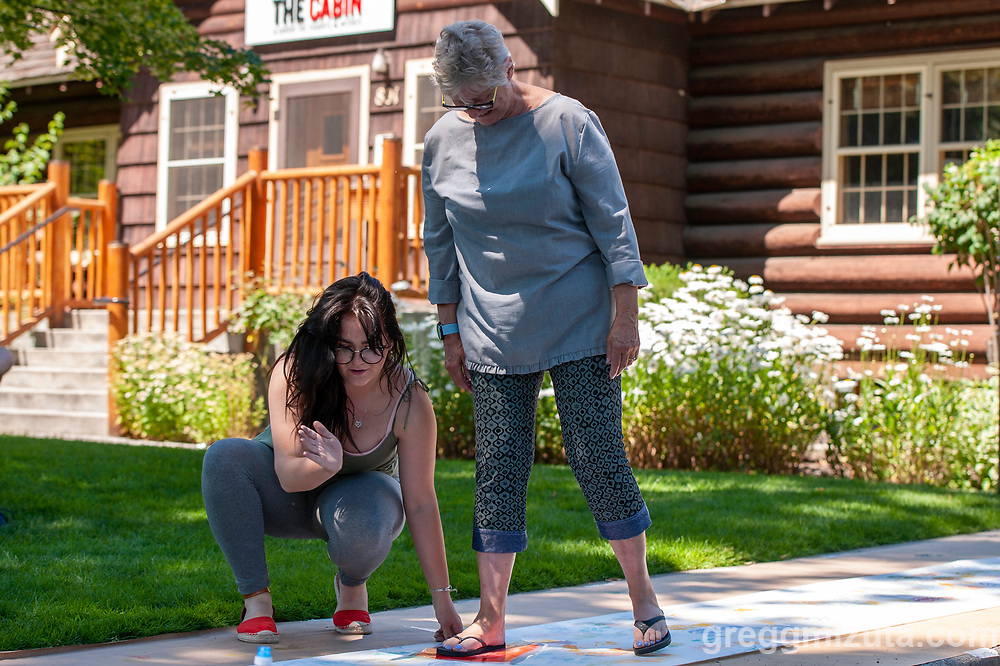 """Amy Nack. Wingtip Press, the City of Boise and Idaho Conservation League's  Print Boise River event at The Cabin, Boise, Idaho on July 13, 2019.<br />  <br /> Wingtip Press, the City of Boise ,and Idaho Conservation League partnered up to celebrate our love for the Boise River.<br /> <br /> This collaborative effort was directed by artist Amy Nack, founder of Wingtip Press and sponsored through a grant from Boise City Arts & History Department.<br /> <br /> PRINT BOISE RIVER participants carved fish, water images, birds and trees, adhered them to the bottom of flip flops and """"walked"""" their image along a 150' feet of paper. Each participant will become a public artist when the mural is displayed during Boise's First Thursday event in August 2019<br /> <br /> Lana Weber, ICL's Community Engagement Coordinator joined art makers to talk about the rivers contribution to our way of life in Boise."""